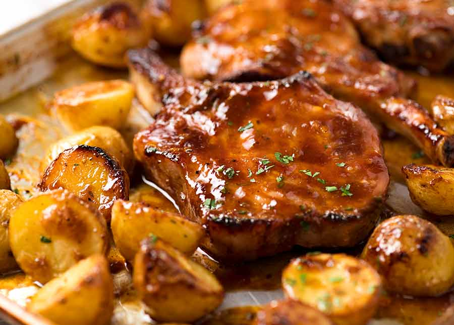 Close up photo of Oven Baked Pork Chops with potatoes, fresh out of the oven