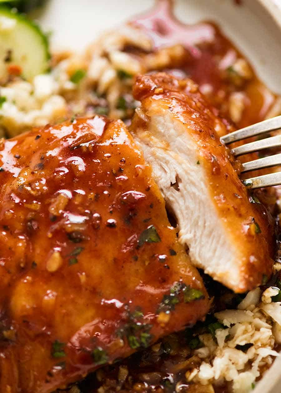 Close up showing inside of juicy chicken breast with Honey Garlic Sauce